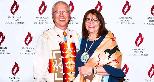 Dr. Cheryl Crazy Bull and Dr. David Yarlott pose for a photo at an American Indian College Fund event.