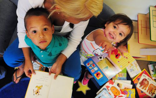 ECE learners at the NWIC center in Beliingham, WA look up at the camera.