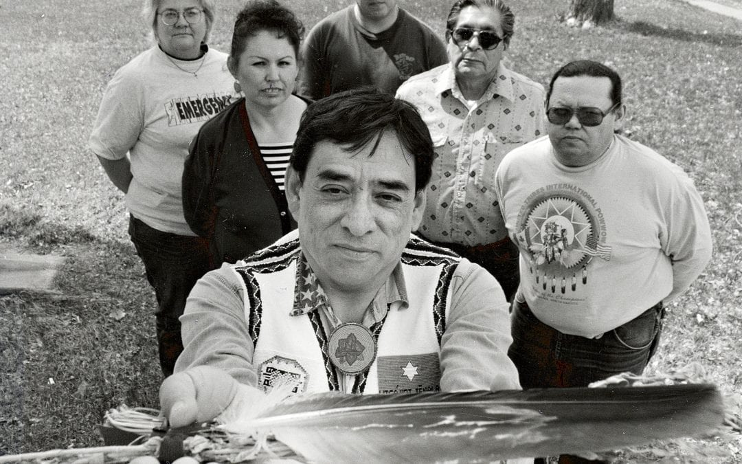 Dr. David Gipp (holding eagle feather) was one of the founders of the tribal college movement.