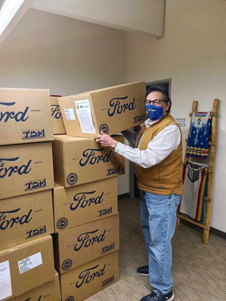 Denver Indian Center Co-Executive Director Rick Waters (Kiowa and Cherokee of Oklahoma) unloads a delivery of personal protective equipment from the Ford Motor Company Fund and the American Indian College Fund.