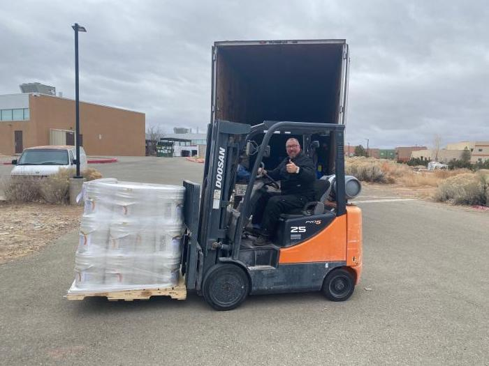 Photo 2: Peter Romero, Director of Facilities and Security at the Institute of American Indian Arts in Santa Fe, New Mexico, readies the college's newly delivered supply.