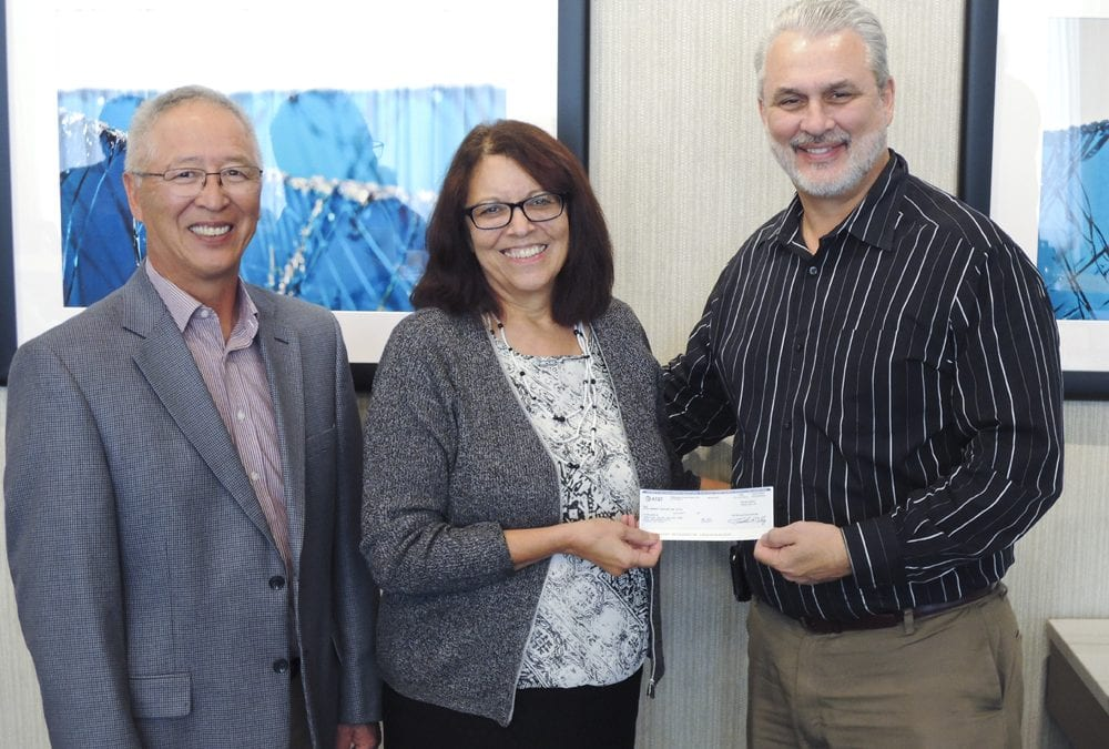 AT&T Presents check to the American Indian College Fund President, Cheryl Crazy Bull.