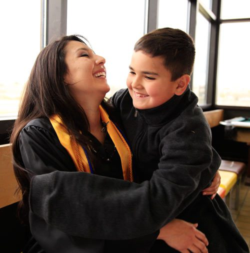 SIPI Graduate Alanna Palmer and her son before Graduation.