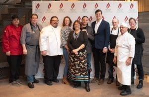 Professional chefs pose at fundraising culinary event for American Indian College Fund.