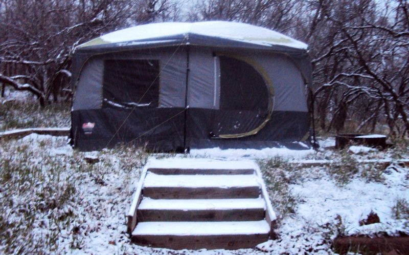 Camping tent gets hit with snow.