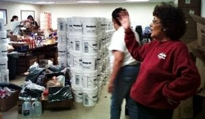 Volunteers from the local BIA assisting with food and cleaning supply distribution.
