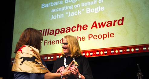 Barbara, the Daughter of Jack Bogle accepts on his behalf the Billapaache Award for his service to the College Fund