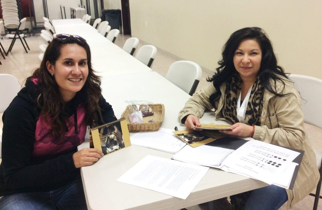 SKC Indigenous Visionaries Fellows Joni Augare Connelly and Kayla Dix showcase the dice game, a traditional Native game, for Salish Kootenai