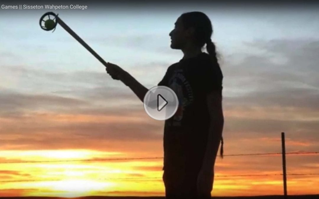 Image of person against a sunset with a link to click to see the Traditional Games (Ehanna Woyute) Film produced by Sisseton Wahpeton College Students on Traditional Dakota Games.