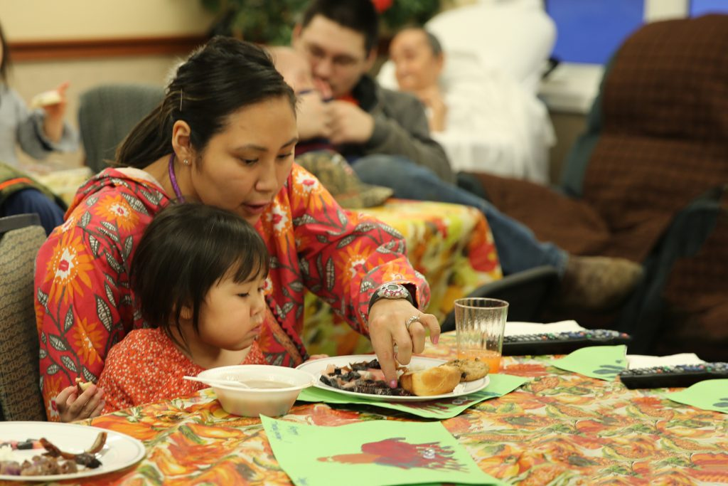 The Iñupiat family engagement event at the Aimaaġvik Assisted Living Center to celebrate the season with a potluck held for the elder residents.