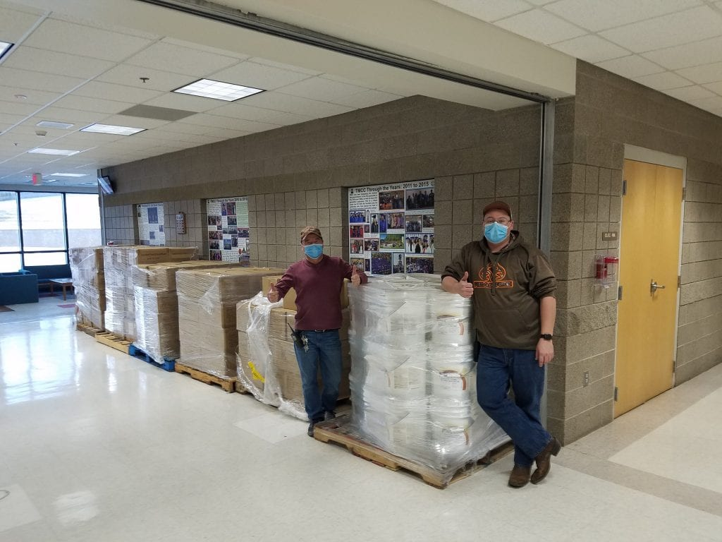 Photo 1: Albert Gourneau (left) and Anthony Desjarlais (right) from Turtle Mountain Community College's facilities department prepare to distribute sanitizing supplies and safety equipment at the tribal college campus in Belcourt, North Dakota.